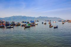 Stock Photo of large group of Vietnamese fishing boats in azure sea