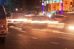 Stock Photo of colourful street garlands illumination intensive night traffic