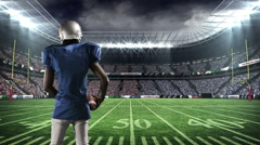 American football player motivating supporters - stock footage