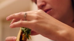 Stock Video Footage of Woman eats a taco for dinner