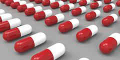 Stock Illustration of red and white color pills on gray grey background