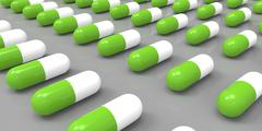 Stock Illustration of white and green color pills on grey gray background