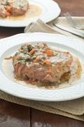 marrowbone, veal cut used in Italian cooking with yellow risotto - stock photo