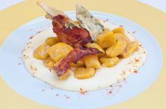 Gnocchi with pumpkin and peanut butter and crispy bacon - stock photo