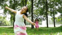 Asian family behide the tree and running together in the park - stock footage