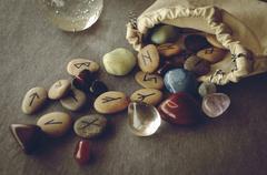 runes and tarot cards - stock photo
