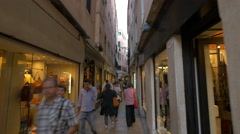 Walking on a narrow street with shops in Venice Stock Footage