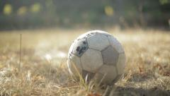 Old soccer ball on nature background Stock Footage