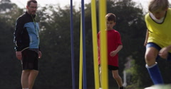 Kids training with a soccer ball on a field. Shot in slow motion on RED Epic. Stock Footage