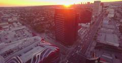 Aerial view of Wilshire Blvd and Fairfax Ave intersection at sunset. 4K UHD. - stock footage