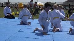 Stock Video Footage of Aikido children make exercises before match outdoor . 4K