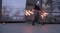 Artistic woman with burning torch start fire juggle performance. 4K Stock Footage