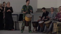 Group musician with African djembe play in city street. 4K Stock Footage