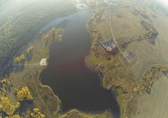 Photo of an autumn lake in forest with a bird's eye view Stock Photos