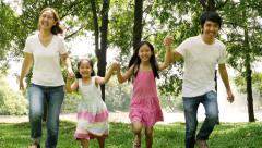 4K Asian family running together in the park - stock footage