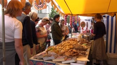 People buy baked cakes with fillings in city market stall . 4K Stock Footage
