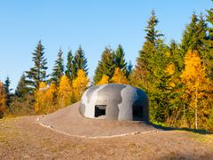 Machine gun turret with camouflage paintings on military bunker - stock photo
