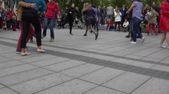 Couples pairs of young people move dance step in street. 4K Stock Footage