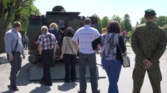 Citizens watch military battle tank in city . 4K Stock Footage