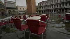Stock Video Footage of Sea level rise - steadicam past Venice cafe under water at high tide, San Marco
