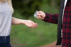Teenage Girl Buying Drugs In Playground From Dealer Stock Photos