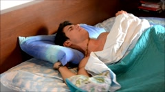 young man sleeping - stock footage