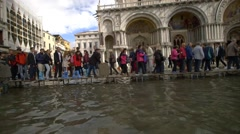 Sea level rise - Venice raised paths, boards, passerelle, at high water Stock Footage