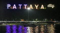 Neon sign in night time of Pattaya, Thailand Stock Footage