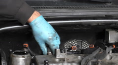 Mechanic disassembling diesel engine fuel system Stock Footage