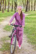 Fitness Smiling Young Woman, Portrait Outdoor with bike, Fresh happy beautifu - stock photo