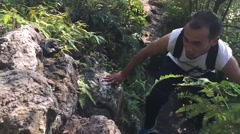 Hill climber climb up the hill Stock Footage