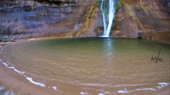 Wide view of waterfall and current against the sand Stock Footage