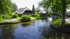 Tourists in boats on the canal of the famous village of Giethoorn in Overijssel. Stock Footage
