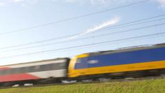 Dutch Railways Intercity Direct train passing at high speed . Stock Footage