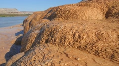 Mineral deposits runoff hand held - stock footage