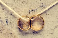 Stock Photo of Wedding rings hanging on rope