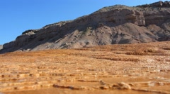 Mineral deposits runoff wide low shot with cliff - stock footage