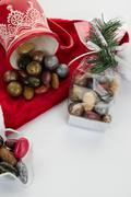 Candy canes, candies and chocolate on Santa hat isolated - stock photo