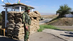 Kurdish Soldier Standing Guard at Base Near Iraq Stock Footage