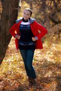 The playful girl walks in autumn park. - stock photo