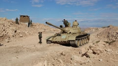 Tank Pulls Forward as Soldier Walks By Stock Footage