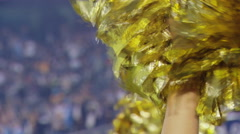 Gold Pom Poms shaken at an NFL football game Stock Footage