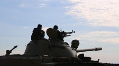 Silhouette of Tank Gunner Preparing His Machine Gun Stock Footage
