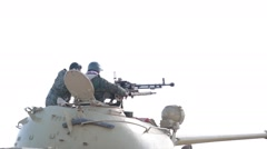 Rear Shot of Tank Gunner Firing His Machine Gun Stock Footage