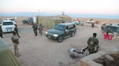 Armed Soldiers and Vehicle in Military Compound Stock Footage