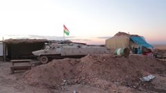 Kurdish Military Outpost with Flag and Armored Fighting Vehicle (AFV) - stock footage