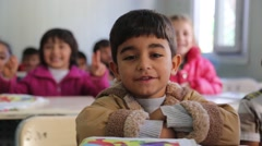 Young Kurdish Children in Classroom Smiling to Camera Stock Footage
