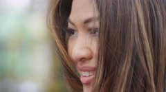 Closeup of a beautiful woman talking to somebody outside Stock Footage