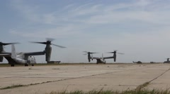 Romania, May 2015, US Marines Two MV 22B Osprey Aircraft Roll Over Airfield Stock Footage