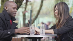 A couple on a date at an outdoor cafe - stock footage